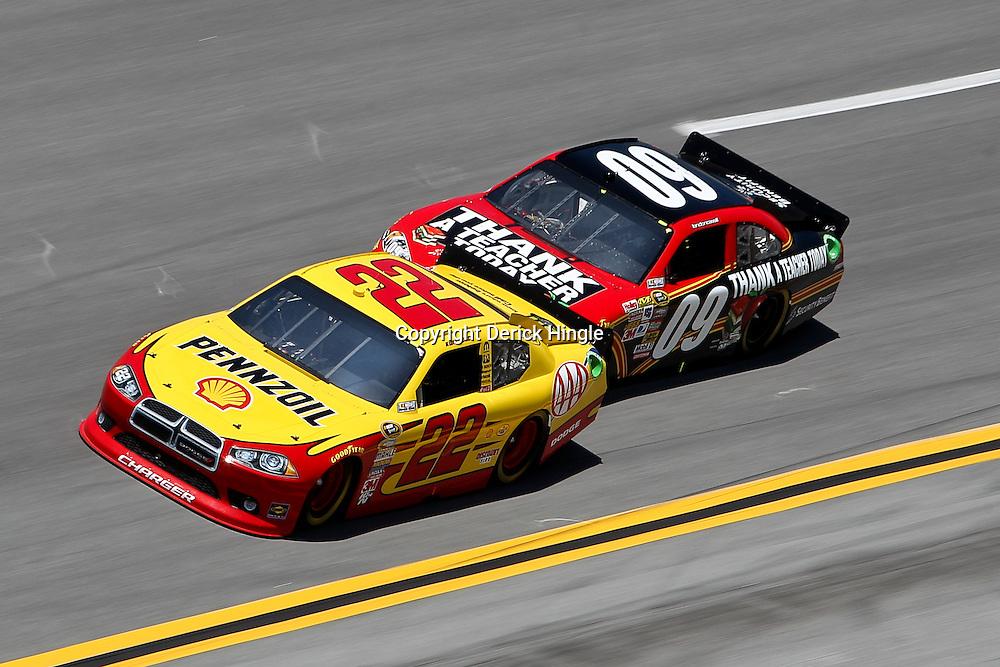 April 17, 2011; Talladega, AL, USA; NASCAR Sprint Cup Series driver Landon Cassill (09) drafts Kurt Busch (22) during the Aarons 499 at Talladega Superspeedway.   Mandatory Credit: Derick E. Hingle