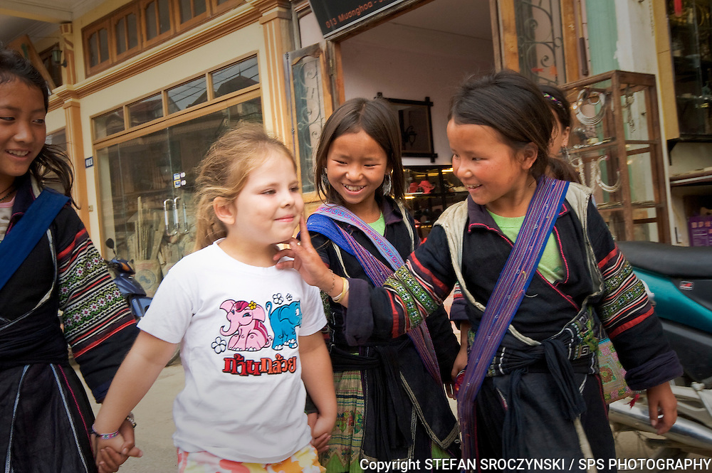 While exploring Sapa in north west Vietnam we encountered a group of local Hmong children who seemed fascinated with my daughter Steffani