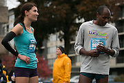 Sarah Loerch of Rochester, the second women's finisher, speaks with Kip Tisia, the second men's finisher, after the East Ave Grocery Run in Rochester on Saturday, November 1, 2014.