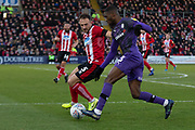 Tranmere Rovers Corey Blackett-Taylor (23) & Lincoln's Harry Toffolo (3) during the EFL Sky Bet League 1 match between Lincoln City and Tranmere Rovers at Sincil Bank, Lincoln, United Kingdom on 14 December 2019.