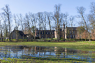 Nederland, Well, 20150302.<br /> Emerson College European Centre op het kasteel in Well, Limburg.<br /> De vroege ochtendzon op het kasteel<br /> <br /> Netherlands, Well, 20150302.<br /> Emerson College European Centre at Castle Well.<br /> Early morning sun shining on the castle <br /> <br /> <br /> Emerson College European Centre op het kasteel in Well, Limburg.<br /> Kasteel Well is een fraaie waterburcht. Het huidige kasteel werd pas gebouwd in de vijftiende eeuw, maar kreeg pas later, in de zeventiende eeuw, zijn huidige aanzicht. Achter het huidige kasteel liggen de resten van een torenmolen uit de vijftiende eeuw. ?Emerson College European Centre at Castle Well.<br /> Kasteel Well is a beautiful moated castle. The present castle was only built in the fifteenth century, it was only later, in the seventeenth century, its current appearance. Behind the present castle lie the remains of a tower mill from the fifteenth century.