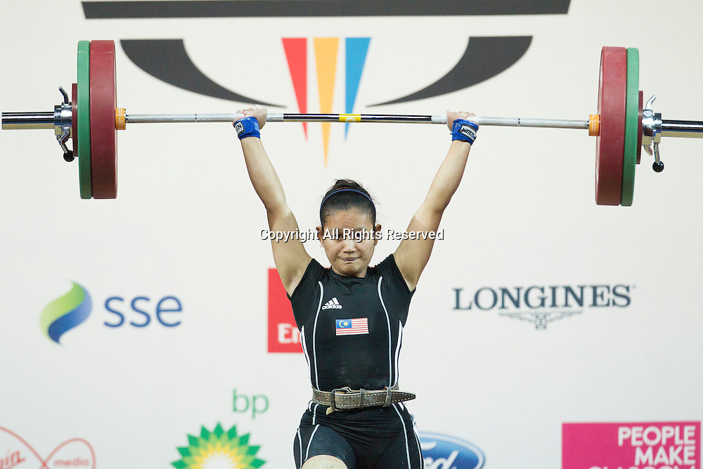 25.07.2014. Glasgow, Scotland. Glasgow Commonwealth Games. Women's 53kg Final. Azizah Fadzil  of MAS during a lift .