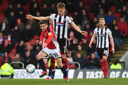 Crewe Alexandra's Tom Lowery(16) and Grimsby Town midfielder Jake Hessenthaler(7) during the EFL Sky Bet League 2 match between Grimsby Town FC and Crewe Alexandra at Blundell Park, Grimsby, United Kingdom on 4 May 2019.
