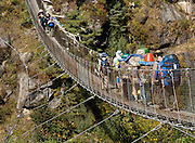 A narrow metal swing bridge, over the Dudh Koshi (or Kosi, river) in Sagarmatha National Park, Nepal. Sagarmatha National Park (created 1976) was honored as a UNESCO World Heritage Site in 1979.
