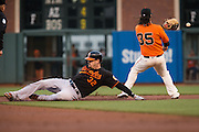 Baltimore Orioles catcher Matt Wieters (32) beats a throw to San Francisco Giants shortstop Brandon Crawford (35) at second base at AT&T Park in San Francisco, Calif., on August 12, 2016. (Stan Olszewski/Special to S.F. Examiner)