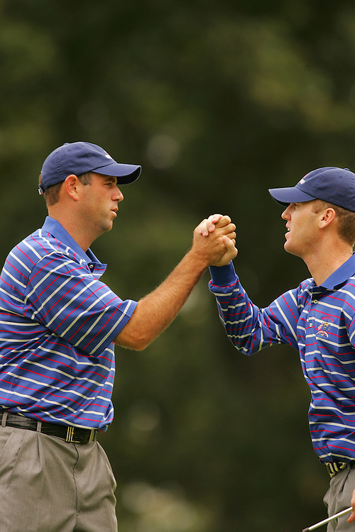 Chris Riley.Stewart Cink..2004 Ryder Cup Matches.Friday, September17 2004.Oakland Hills CC.Bloomfield Hills, MI..photograph by Darren Carroll