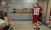 Equipment managers work in the Mal Moore Athletic Facility to get the University of Alabama football team ready for the trip to Baton Rouge to face LSU.  AJ McCarron's back up jersey hangs in the laundry room drying in the breeze of fan.  Photo by Gary Cosby Jr.