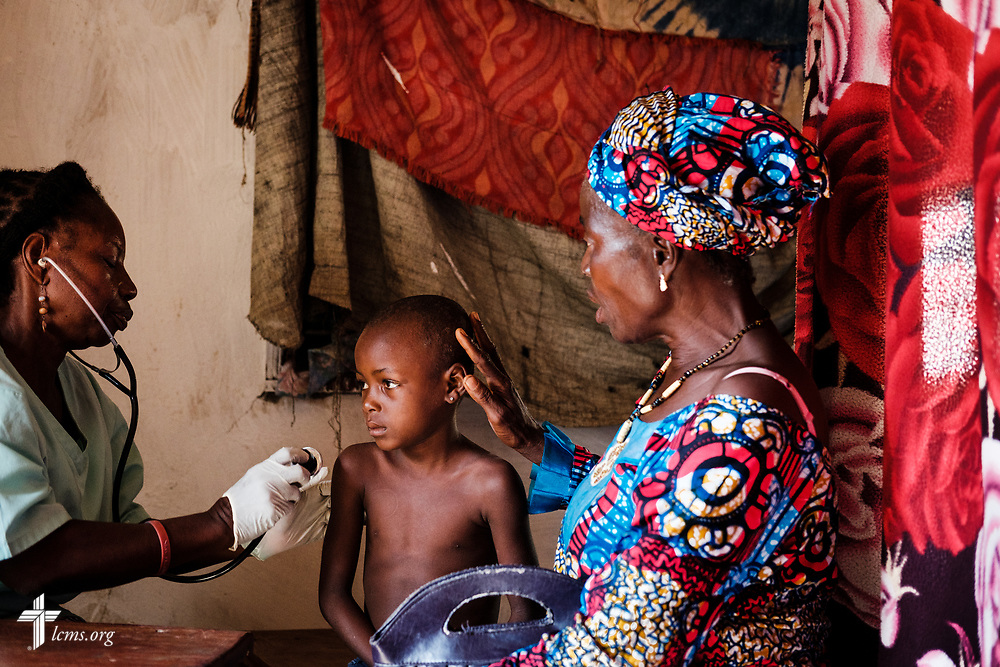 A Sierra Leone medical professional treats a young patient during the second day of the LCMS Mercy Medical Team on Tuesday, May 8, 2018, in the Yardu village outside Koidu, Sierra Leone, West Africa. LCMS Communications/Erik M. Lunsford