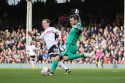 Preston North End goalkeeper Chris Maxwell (22) clearing from Fulham midfielder Stefan Johansen (14) during the EFL Sky Bet Championship match between Fulham and Preston North End at Craven Cottage, London, England on 4 March 2017. Photo by Matthew Redman.