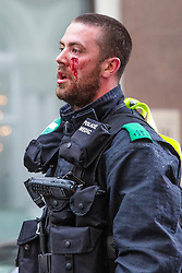 © Licensed to London News Pictures. 09/06/2018. London, UK. An officer is injured as members of the UK far right activist groups protest outside the gates to 10 Downing Street and surrounding areas against the prison sentence of TOMMY ROBINSON, aka STEPHEN YAXLEY-LENNON. Mr ROBINSON was arrested and sentenced to 13 months in prison on May 25th outside Leeds Crown Court while while breaking a reporting restriction on a case set by the judge. Photo credit: Hugo Michiels/LNP