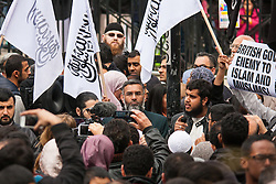 "London, April 18th 2014. as British right wing nationalists counter-demonstrate Anjem Choudary (centre) and his Islam4UK group protest at Regent's Park Mosque after Friday prayers, against ""Cameron's crusades"" in the middle East."