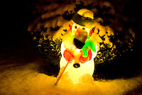 A snow-covered, glowing, Frosty the Snowman.