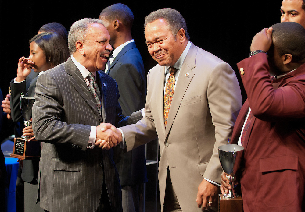 Howard University President Sidney Ribeau, left, shakes hands with Morehouse College President Robert Franklin, right, at the conclusion of the Mordecai Wyatt Johnson-Benjamin Elijah Mays student debate held at Howard University on Friday as part of the AT&T Nation's Football Classic.(Photo by Alan Lessig)