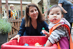 © Licensed to London News Pictures. 08/09/2015. London, UK. Labour party leadership candidate, LIZ KENDALL MP plays with Chanya Chitprasert, aged 20 months during her visit Clapham Manor Children's Centre in south west London. Photo credit : Vickie Flores/LNP