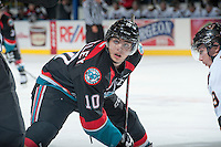 KELOWNA, CANADA - OCTOBER 22: Nick Merkley #10 of the Kelowna Rockets faces off against the Calgary Hitmen on October 22, 2013 at Prospera Place in Kelowna, British Columbia, Canada.   (Photo by Marissa Baecker/Shoot the Breeze)  ***  Local Caption  ***