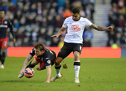 Derby County's Cyrus Christie fouls Reading's Simon Cox - Photo mandatory by-line: Alex James/JMP - Mobile: 07966 386802 - 14/02/2015 - SPORT - Football - Derby  - ipro stadium - Derby County v Reading - FA Cup - Fifth Round