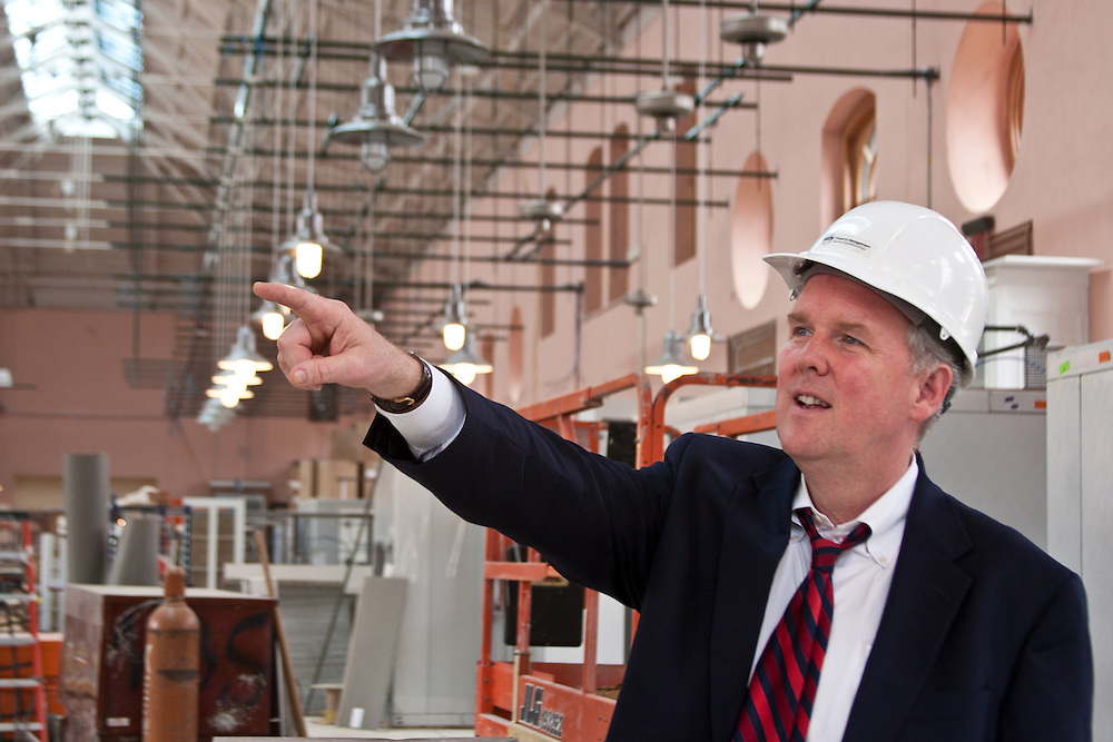 Ward 6 Councilman Tommy Wells inspects the progress of the Eastern Market's reconstruction.