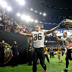 Oct 16, 2016; New Orleans, LA, USA; New Orleans Saints running back Daniel Lasco (36) and quarterback Drew Brees (9) celebrate following a win against the Carolina Panthers in a game at the Mercedes-Benz Superdome. The Saints defeated the Panthers 41-38. Mandatory Credit: Derick E. Hingle-USA TODAY Sports