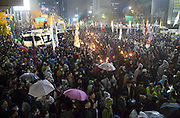 "People hold torches as the police block their march toward the presidential Blue House during an anti-government protest in central Seoul, South Korea, November 14, 2015. ""The People's Camp for Rising Up and Fighting"", representing various groups of farmers, students, workers and the poor, demonstrated to oppose South Korean government's plans to change the labor market and monopolize the authorship of history textbooks. Policemen set up vehicle barriers and used water cannon to break up people. The organizer said 130,000 people participated in the demo, while the police said 68,000 attended. Photo by Lee Jae-Won"