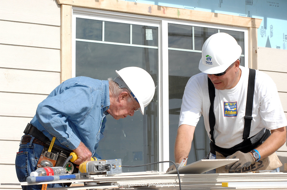 Former President and Nobel laureate Jimmy Carter, left, works alongside volunteer Mike Bean building a house with Habitat for Humanity, in San Pedro, Calif. As part of the Jimmy Carter Work Project now in its 24th year, 100 houses will be built or rehabilitated in Los Angeles by the end of the year, to help low-income families realize the dream of home ownership. Photo/Habitat for Humanity, Susan Goldman.