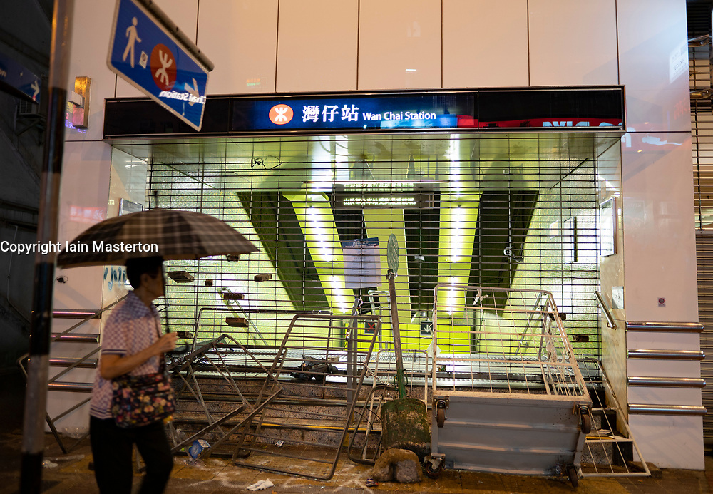 Hong Kong. 6 October 2019. Tens of thousands of pro-democracy protestors march in pouring rain through centre of Hong Kong today from Causeway Bay to Central. Peaceful march later turned violent as a hard-core of protestors confronted police. Pic; Vandalised entrance to Wanchai MTR station. Iain Masterton/Alamy Live News.