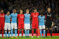 MANCHESTER, ENGLAND - Saturday, November 21, 2015: Liverpool's and  Manchester City players stand during the French national anthem before the Premier League match at the City of Manchester Stadium. (Pic by David Rawcliffe/Propaganda)