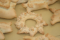 decorated bread shapes on counter after cooking, flowers and dove decorations, Sardinian bread sculpture, the Pani Pintau