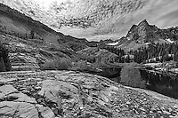 Monochrome view of Sundial Peak near Lake Blanche in Big Cottonwood Canyon, which is part of the Wasatch Mountains near Salt Lake City. An early morning storm clears up to provide a grand landscape only minutes away from the city.