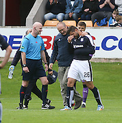 Kostadin Gadzhalov is comforted by Brechin club doctor Alistair Shaw as he goes off after picking up a shoulder injury - Brechin City v Dundee, pre-season friendly at Starks Park<br /> <br />  - &copy; David Young - www.davidyoungphoto.co.uk - email: davidyoungphoto@gmail.com
