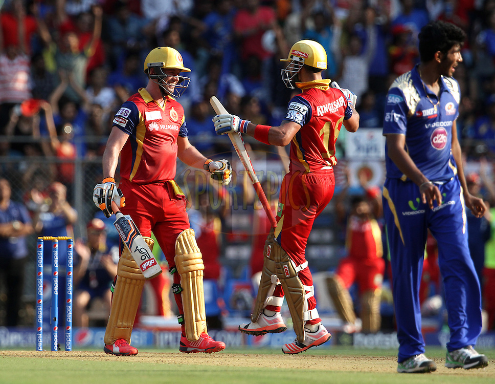 Royal Challengers Bangalore captain Virat Kohli congratulates Royal Challengers Bangalore player AB De Villiers after he scores a hundred during match 46 of the Pepsi IPL 2015 (Indian Premier League) between The Mumbai Indians and The Royal Challengers Bangalore held at the Wankhede Stadium in Mumbai, India on the 10th May 2015.<br /> <br /> Photo by:  Vipin Pawar / SPORTZPICS / IPL