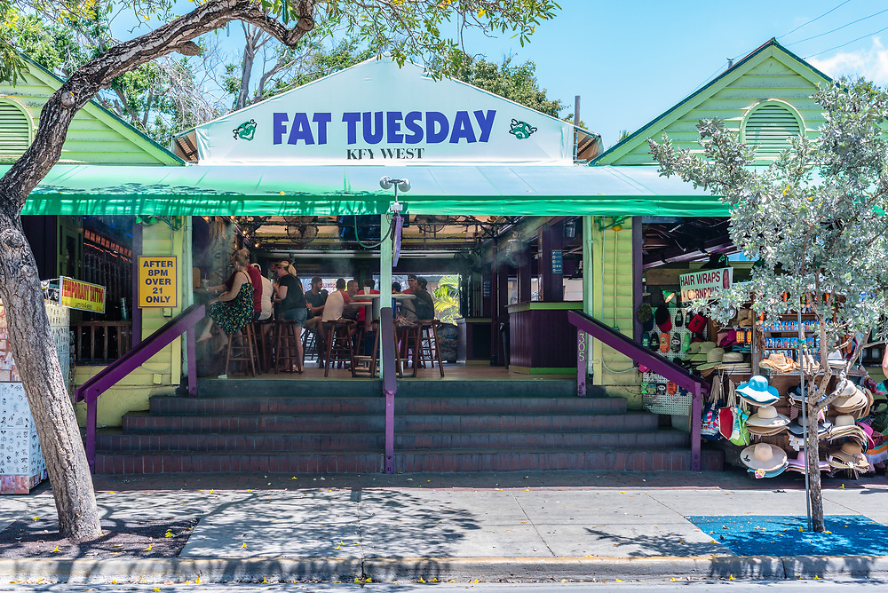 Key West, Florida--April 29, 2018. Patrons are enjoying afternoon cocktails in the open aired Fat Tuesday's in Key West. Editorial Use Only.