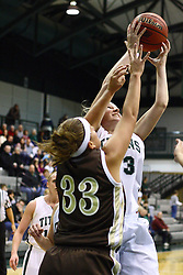 17 December 2011:  Shelby Jackson and Jen Andes reach for a rebound during an NCAA womens division 3 basketball game between the St. Francis Fighting Saints and the Illinois Wesleyan Titans in Shirk Center, Bloomington IL