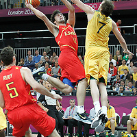 31 July 2012: Spain Sergio Llull goes for the layup against Australia Joe Ingles during the 82-70 Spain victory over Australia, during the men's basketball preliminary, at the Basketball Arena, in London, Great Britain.