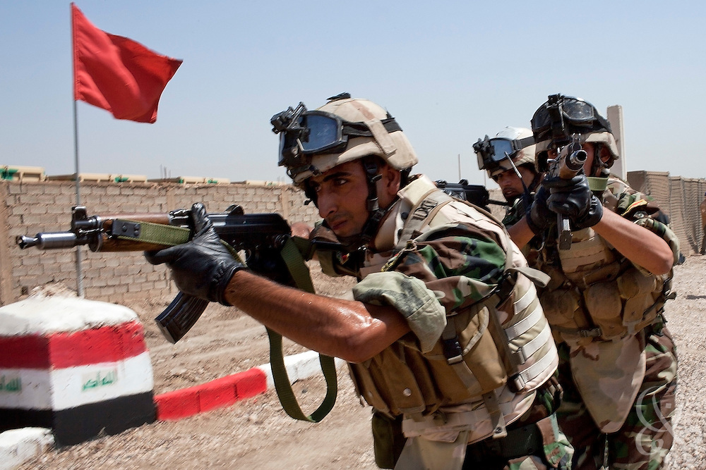 17th Iraqi Division soldiers move in a stack formation during training exercises August 30, 2010 at the Joint Security Station (JSS) Deason in Mahmoudiyah, Iraq.