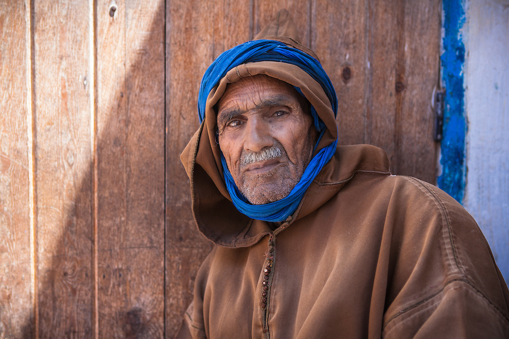 Portrait of an old muslim man, wearing a traditional djellaba, in the old medina of Essaouira, western Morocco.