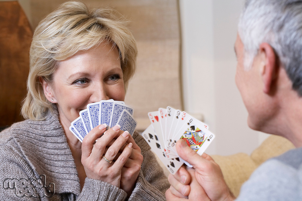 Middle-aged couple playing cards