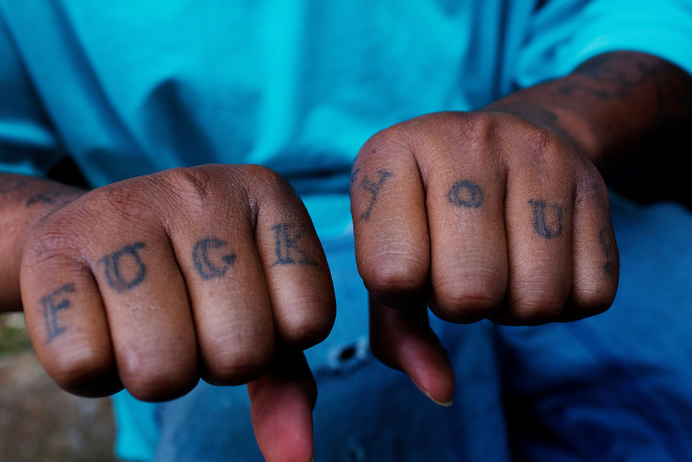 "Lorenzo ""Redd"" Taylor displays a tattoo he recently received in the Baptist Town neighborhood of Greenwood, Mississippi on Wednesday, May 19, 2010. He went to prison not long after this image was made."