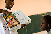 A teacher holds a visual dictionary during a class on mine awareness at the Nyassia primary school in the village of Nyassia, Senegal, on Thursday June 14, 2007.