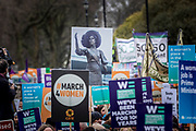 UNITED KINGDOM, London: 04 March 2018 A poster showing the bronze statue of suffragette leader Emmeline Pankhurst stands among other picket signs during the #March4Women rally through London this afternoon. Thousands of people marched from Parliament to Trafalgar Square to celebrate International Women's Day and 100 years since the first women in the UK gained the right to vote. <br /> Rick Findler / Story Picture Agency