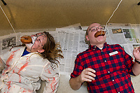 """Delaney Sleeper  aka """"Zipper Face"""" and Youth Librarian John Locke see who can eat a donut off the string fastest during the Tween/Teen Halloween party Tuesday afternoon at the Meredith Community Center.  (Karen Bobotas/for the Laconia Daily Sun)"""
