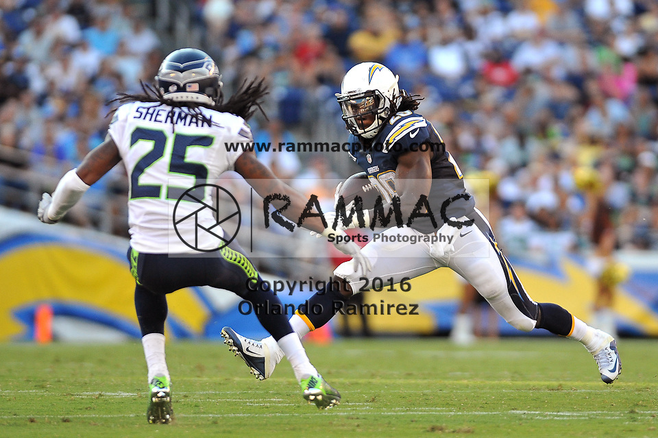 Aug 29, 2015; San Diego, CA, USA; Seattle Seahawks cornerback Richard Sherman (25) attempts to tackle San Diego Chargers running back Melvin Gordon (28) at Qualcomm Stadium. Mandatory Credit: Orlando Ramirez-USA TODAY Sports