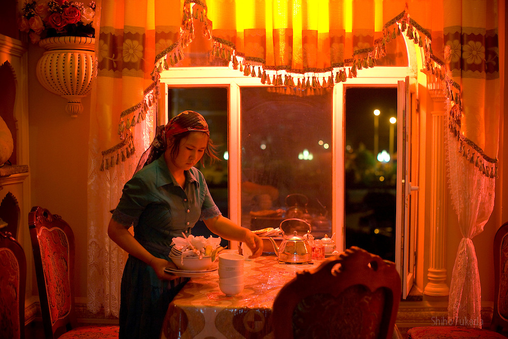 An Uighr waitress works at the Altun Zardar restaurant, in Yarkand, Xinjiang province in China.