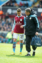 BIRMINGHAM, ENGLAND - Easter Sunday, March 31, 2013: Aston Villa's Joe Bennett walks off injured during the Premiership match against Liverpool at Villa Park. (Pic by David Rawcliffe/Propaganda)