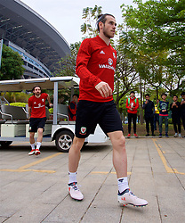 NANNING, CHINA - Sunday, March 25, 2018: Wales' Gareth Bale and Joe Allen arrive for a training session at the Guangxi Sports Centre ahead of the 2018 Gree China Cup International Football Championship final match against Uruguay. (Pic by David Rawcliffe/Propaganda)