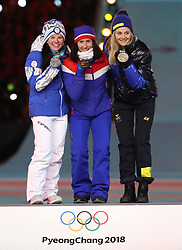PYEONGCHANG, Feb. 25, 2018  Gold medalist Norway's Marit Bjoergen (C), silver medalist Finland's Krista Parmakoski (L) and bronze medalist Sweden's Stina Nilsson pose for photos during medal ceremony for ladies' 30km mass start classic of cross-country skiing at the closing ceremony for the 2018 PyeongChang Winter Olympic Games at PyeongChang Olympic Stadium, PyeongChang, South Korea, Feb. 25, 2018. (Credit Image: © Bai Xuefei/Xinhua via ZUMA Wire)