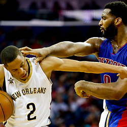 Mar 1, 2017; New Orleans, LA, USA; Detroit Pistons center Andre Drummond (0) commits a personal foul against New Orleans Pelicans guard Tim Frazier (2) a during the second half of a game at the Smoothie King Center Drummond was ejected following the altercation. The Pelicans defeated the Pistons 109-86. Mandatory Credit: Derick E. Hingle-USA TODAY Sports