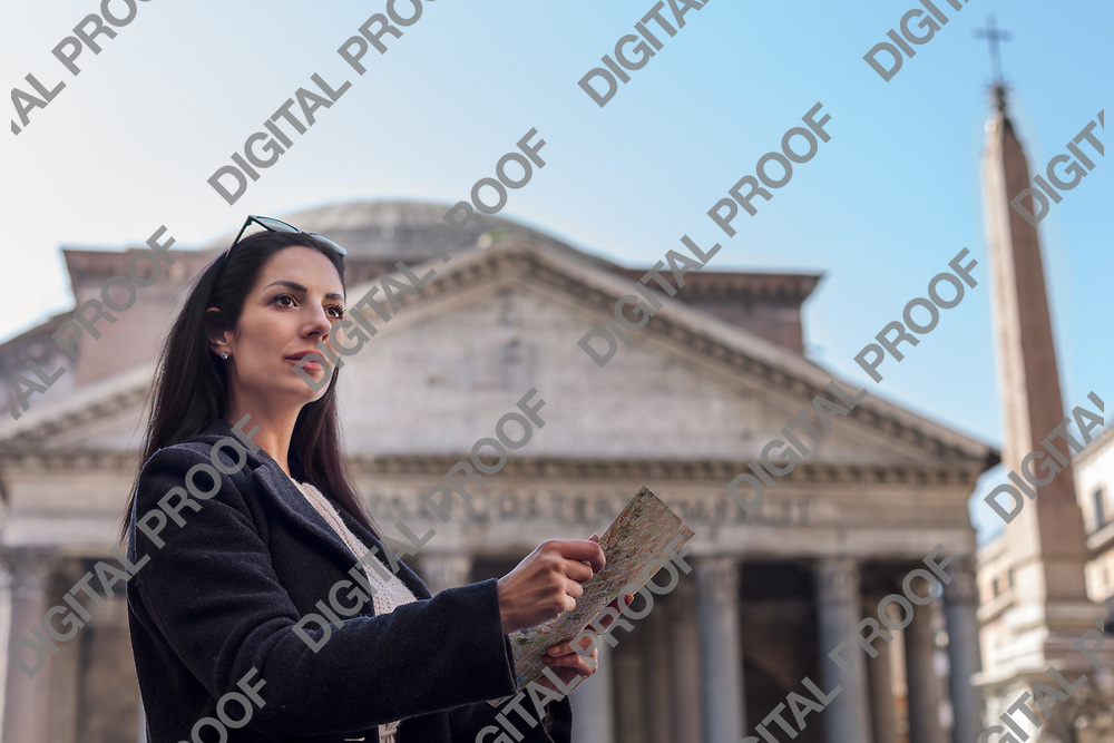 Concerned tourist woman hold pensative a map at the Pantheon in Rome Italy