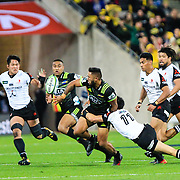 Vince Aso  passes during the Super Rugby union game between Hurricanes and Sunwolves, played at Westpac Stadium, Wellington, New Zealand on 27 April 2018.   Hurricanes won 43-15.