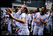 Teens dance wildly during obby oss parade on May Day in Padstow; Cornwall, England.