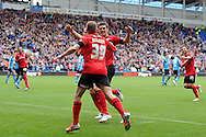 Cardiff city's Craig Bellamy celebrates with Mark Hudson after he scores the opening goal. NPower championship, Cardiff city v Leeds United at the Cardiff city stadium in Cardiff, South Wales on Sat 15th Sept 2012.   pic by  Andrew Orchard, Andrew Orchard sports photography,